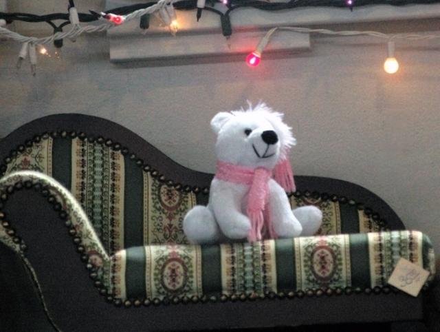 Teddy Bear sitting on a mini chaise longue