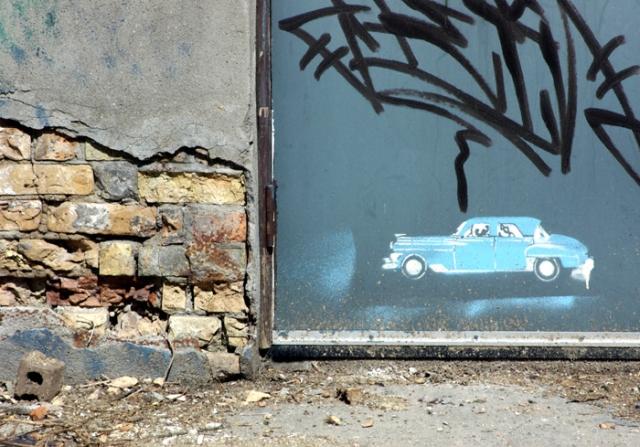 Car stencilled on a door