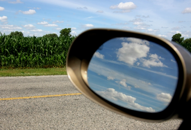 Clouds reflecting in a car's mirror