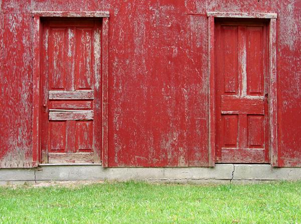 Two Worn Red Doors